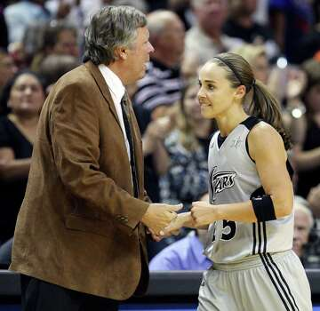 FOR SPORTS - San Antonio Silver Stars' head coach Dan Hughes shakes hands with San Antonio Silver Stars' Becky Hammon as she heads to the bench late in Game 2 of the Western Conference semifinal with the Minnesota Lynx  Sunday Sept. 18, 2011 at the AT&T Center. The Silver Stars won 84-75. (PHOTO BY EDWARD A. ORNELAS/eaornelas@express-news.net) Photo: EDWARD A. ORNELAS, SAN ANTONIO EXPRESS-NEWS / SAN ANTONIO EXPRESS-NEWS (NFS)