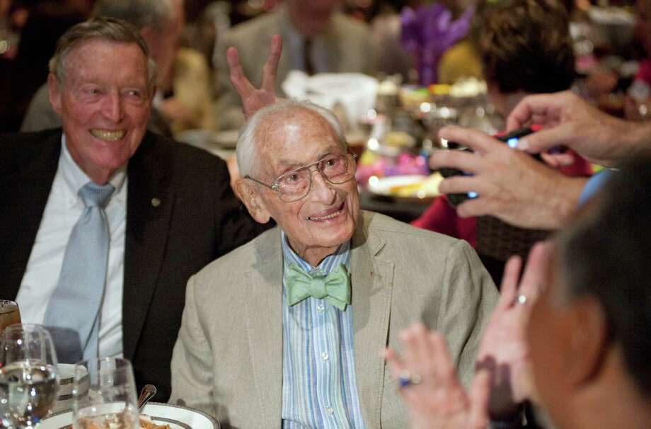 "Bill Sinkin poses for a photo as Tom Frost, left, puts ""bunny ears"" on him during his 99th birthday party and roast, Friday, May 18, 2012, at Pearl Stable in San Antonio. Photo: Darren Abate, SPECIAL TO THE EXPRESS-NEWS / SAN ANTONIO EXPRESS-NEWS"