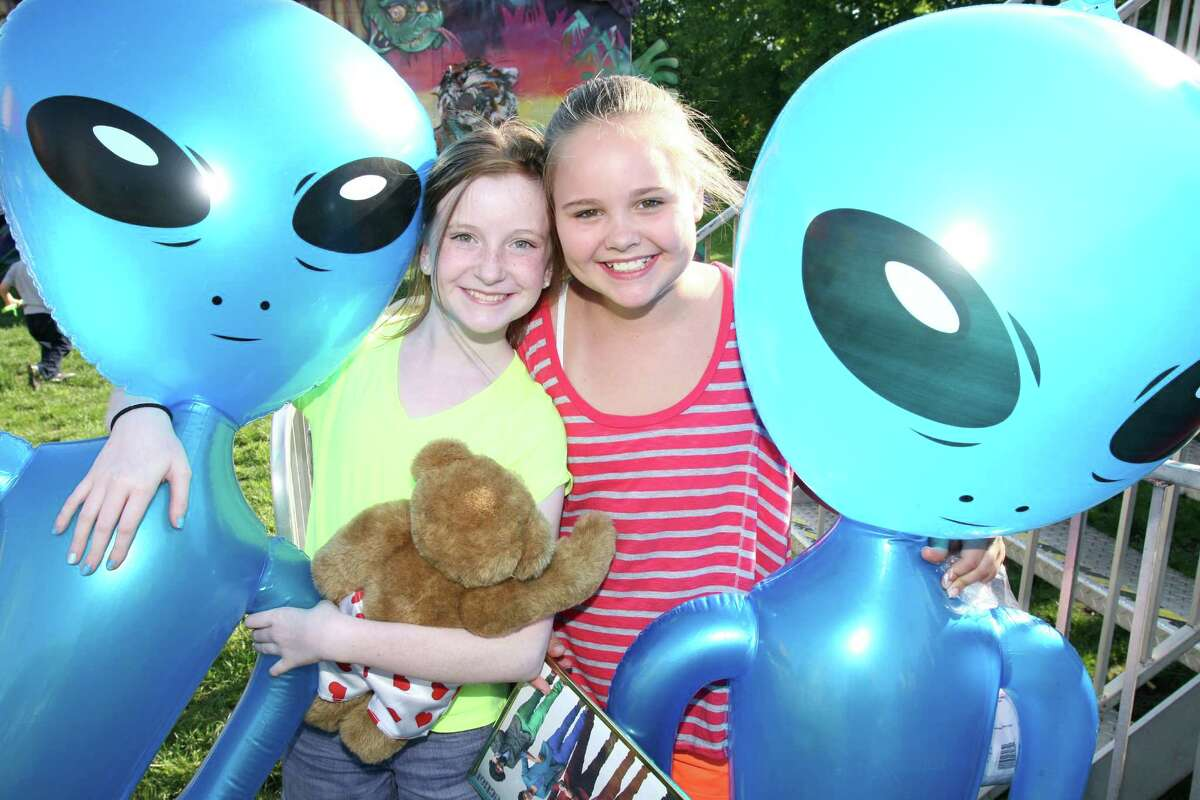 Pearl Cadigan, left, and Lucy Massam hold the prizes they won while at the first day of the Cos Cob May Fair Friday, May 18, 2012.