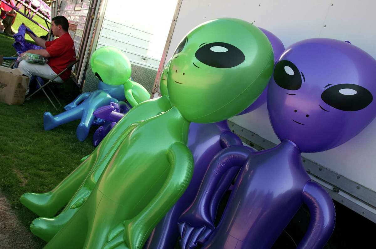 Prizes are inflated during the first day of the Cos Cob May Fair, which started Friday, May 18, 2012.