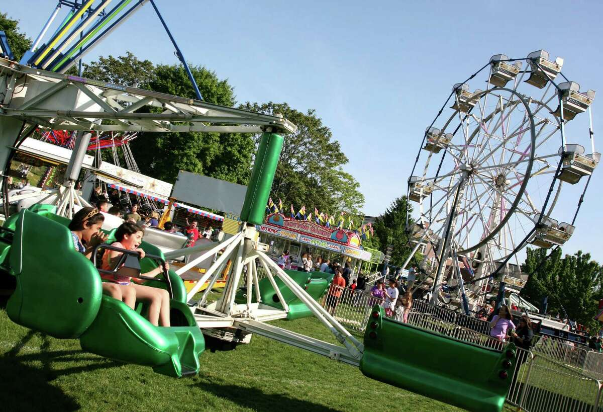 There are all kinds of games and rides at the Cos Cob School' s annual May Fair, which started on Friday, May 18, 2012.