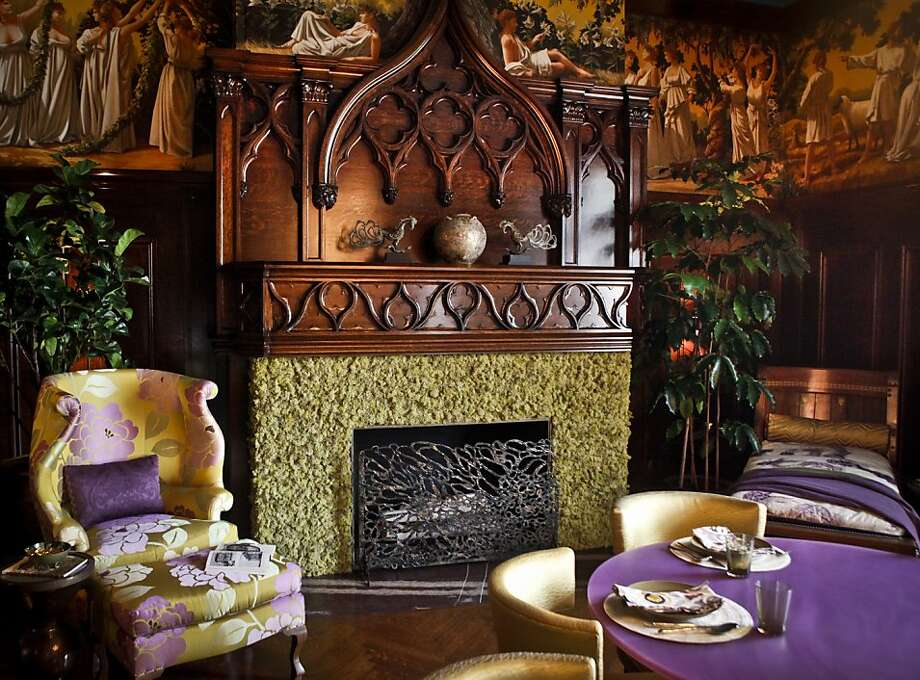 The reindeer moss surround on the fireplace in the dining room by Marysia Rybock of ScavulloDesign is seen on Monday, May 14, 2012 in San Francisco, Calif., at the Decorator Showcase. Photo: Russell Yip, The Chronicle