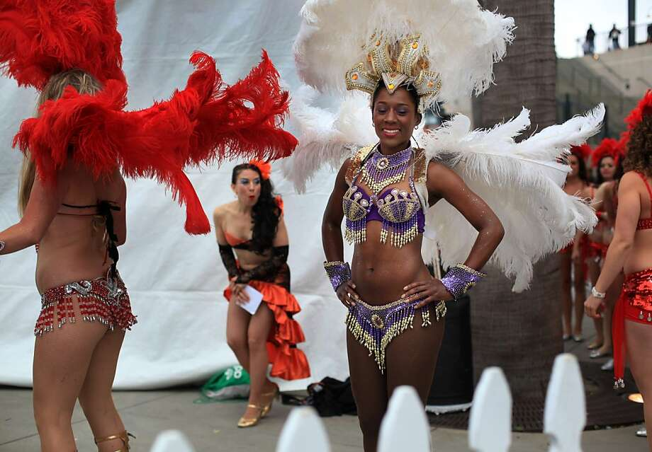 Temi Ogunyoku, a dancer with the Brazilian dance contingent, Samba Da Terra works on a smile before her performance at Carnaval with the Giants event at Seal's Plaza behind AT&T Park on May 16, 2012 in San Francisco, Calif. Photo: Mike Kepka, The Chronicle