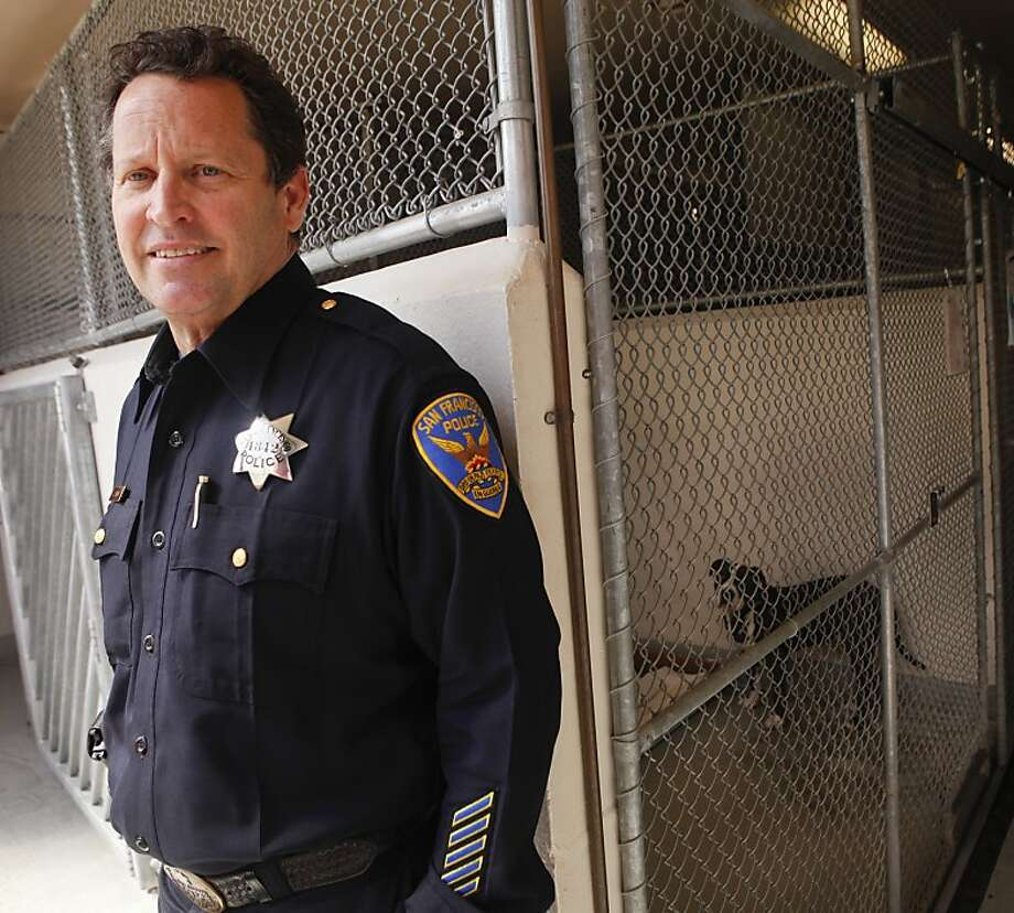 San Francisco Police Officer John Denny, seen in one of the adoptable dog kennels at Animal Care and Control in San Francisco, Calif., on Thursday, April 26, 2012, adjudicates vicious dog hearings and keeps a list of vicious dogs who live in the city. Photo: Russell Yip, The Chronicle