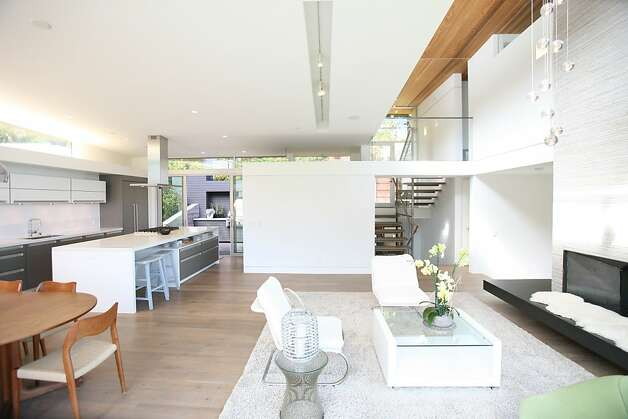 The open-concept living area flows into the kitchen and dining space. Photo: Sean McCardle