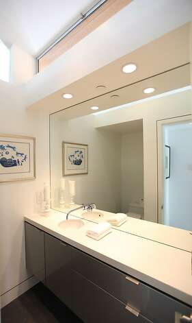 Clean lines create a modern half bath. Photo: Sean McCardle
