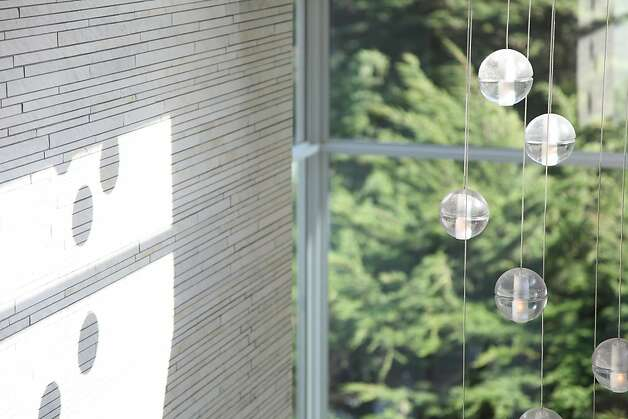 Pendant lighting casts unique shadows along the textured wall. Photo: Sean McCardle