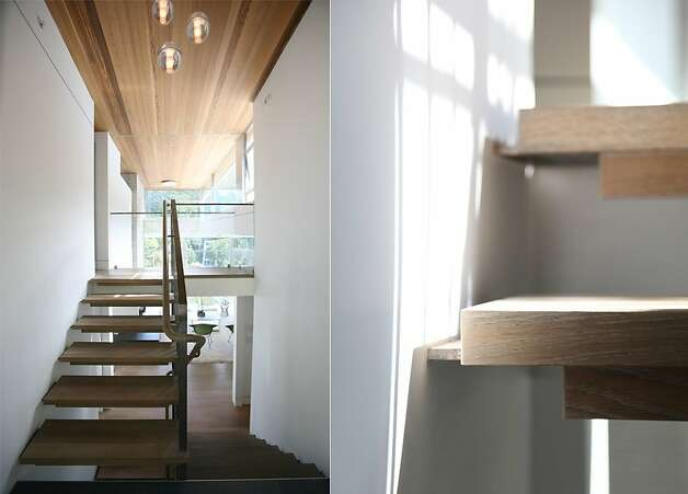 Hardwood details enhance the entry's ceiling and multi-level staircase. Photo: Sean McCardle