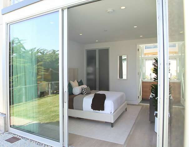 Sliding glass doors in the master suite provide exterior access. Photo: Sean McCardle