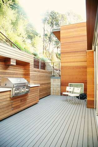 A built-in grill highlights the private deck, which sits just off the kitchen. Photo: Sean McCardle