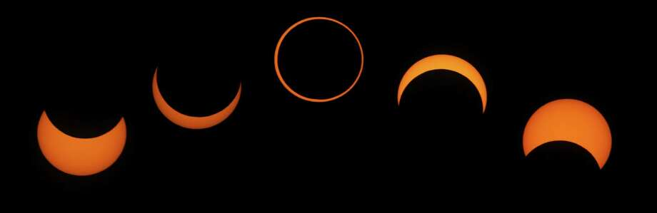 This combination picture of five pictures shows the phases of an annular solar eclipse as seen from Segovia in central Spain on Oct. 3, 2005. Photo: VICTOR FRAILE / X01331