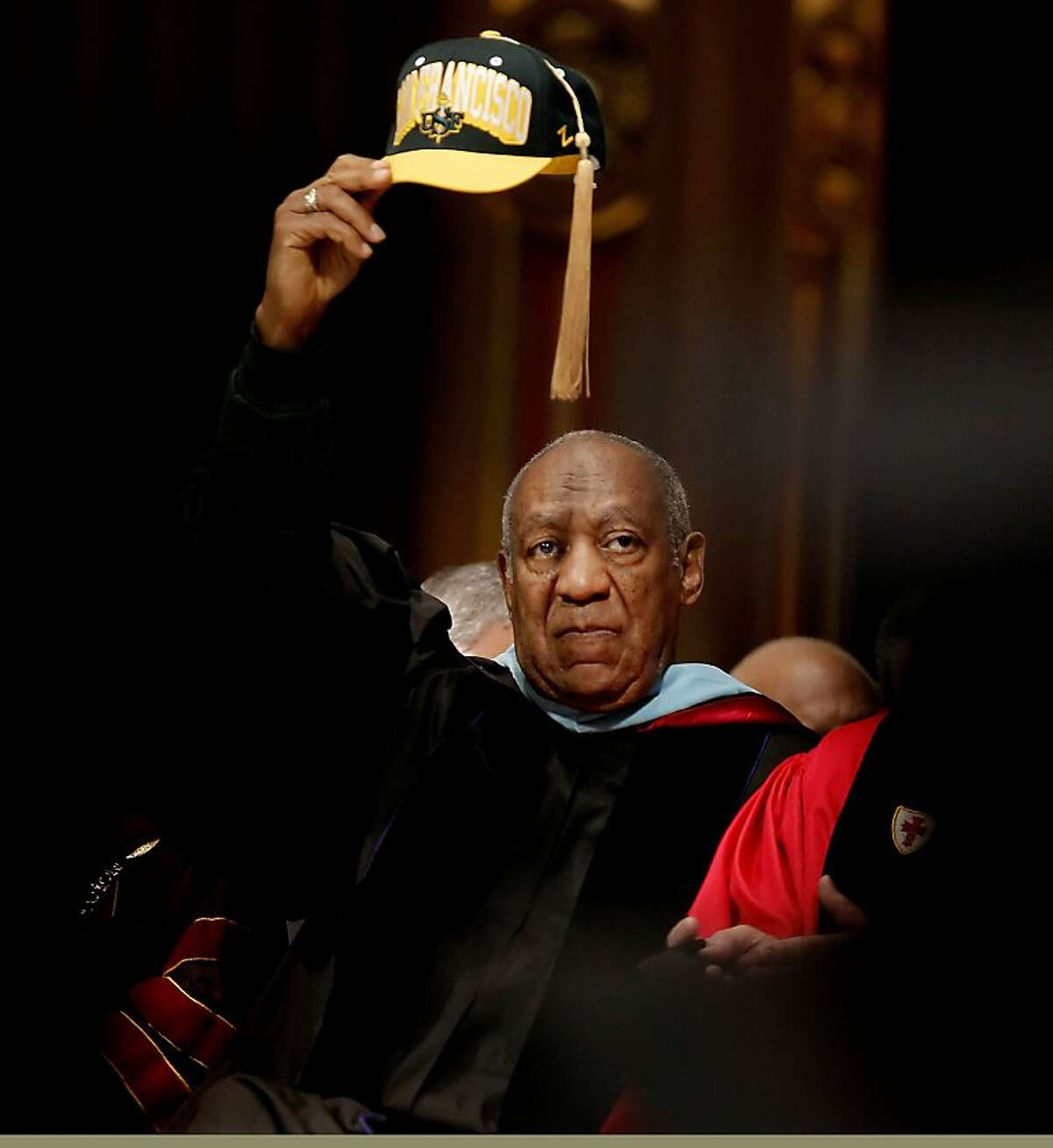 Comedian and educator, Bill Cosby, raisces his cap high as he prepares to deliver the commencement speech to the graduating students of Arts and Social Sciences at the University of San Francisco, on Friday May 18, 2012, at St. Ignatius Church in San Francisco,Ca.