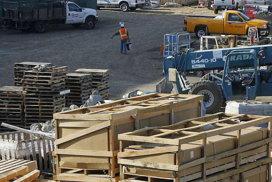 A worker walks through a construction site where work remains suspended at Santa Clara Valley Medical Center in San Jose, Calif. on Friday, May 18, 2012, until a judge approves an order to remove about 100 coffins discovered on the site three months ago. County officials believe that as many as 4,500 indigent residents were buried there about 100 years ago. Photo: Paul Chinn, The Chronicle