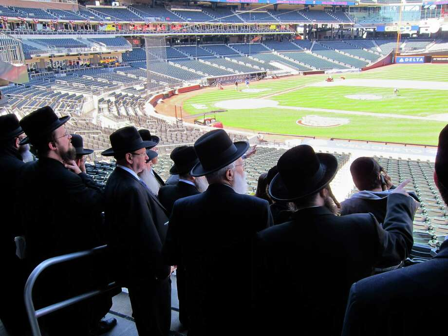 In this April 3, 2012 photo provided by VosIzNeias.com, a group of Ultra Orthodox Jews who believe that the Internet threatens their way of life, check out the facilities at New York's Citi Field, which they ultimately rented for an unprecedented gathering. The upcoming May 20 rally at the Mets' Stadium will address how to use modern technology in a religiously appropriate way. More than 40,000 ultra-Orthodox Jewish men plan to pack Citi Field for the Sunday evening gathering on the dangers of the Internet, and organizers have also rented the nearby Arthur Ashe Stadium for the overflow crowd. (AP Photo/VosIzNeias.com) MANDATORY CREDIT Photo: Anonymous