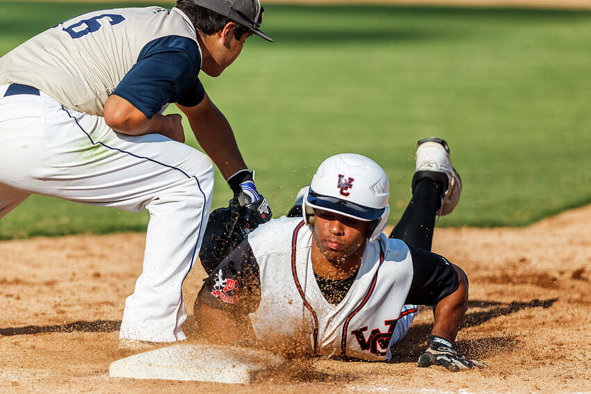 Churchill's Dimitri Flowers slides back to first base to avoid a pickoff by O'Connor's Daniel Cruz during the opener of their best-of-3 third round series at Nelson Wolff Stadium on May 18, 2012. O'Connor held the Chargers to two hits and came away with a 3-1 victory. MARVIN PFEIFFER/ mpfeiffer@express-news.net