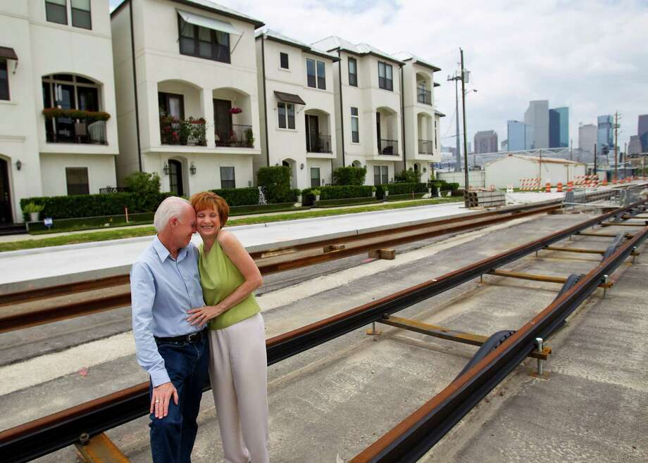 Trish and Kevin Rigdon, empty-nesters and Dynamo season ticket holders, bought a three-story townhouse in 2010 that's now just a few blocks from the stadium and across Texas Street from the light-rail line. Photo: Karen Warren / © 2012  Houston Chronicle