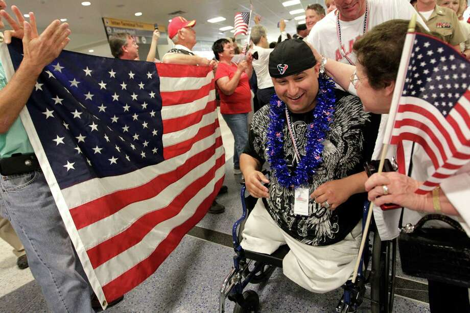 U.S. Army Sgt. Shane Parsons was one of more than 260 injured veterans welcomed at George Bush Intercontinental Airport. They'll spend the weekend fishing at Port O'Connor, hosted by Wounded Warriors in Victoria. Photo: Mayra Beltran / Houston Chronicle