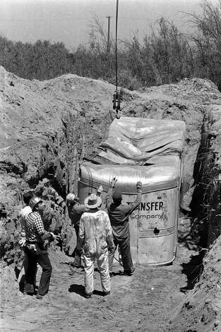 FILE - In this July 20, 1976 file photo, officials remove a truck buried at a rock quarry in Livermore, Calif., in which 26 Chowchilla school children and their bus driver, Ed Ray were held captive. Ray, the school bus driver hailed as a hero for helping 26 students escape after three men kidnapped the group and buried the entire bus underground in 1976 died on Thursday, May 17, 2012. He was 91.  (AP Photo, File) Photo: James Palmer, Associated Press