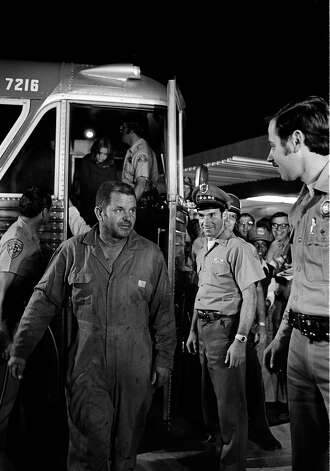FILE - In this July 17, 1976 file photo, school bus driver Ed Ray Jr. steps from the bus that returned him and 26 school children home to Chowchilla, Calif., after the were kidnapped by three men. Ray, the school bus driver hailed as a hero for helping 26 students escape after three men kidnapped the group and buried the entire bus underground in 1976 died on Thursday, May 17, 2012. He was 91. (AP Photo) Photo: Jim Palmer, Associated Press