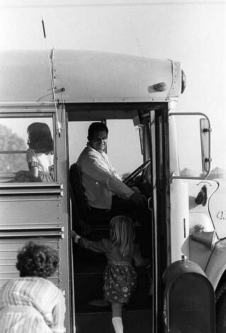 FILE - In this Sept. 13, 1976 file photo, bus driver Ed Ray, who was kidnapped with 26 school children from Chowchilla, waits for a passenger as school starts  for the fall term.  Ray, the school bus driver hailed as a hero for helping 26 students escape after three men kidnapped the group and buried the entire bus underground in 1976 died on Thursday, May 17, 2012. He was 91.(AP Photo) Photo: Anonymous, Associated Press