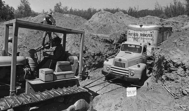 FILE - In this July 20, 1976 file photo, officials remove a truck buried at a rock quarry in Livermore, Calif., in which 26 Chowchilla school children and their bus driver, Ed Ray were held captive. Ray, the school bus driver hailed as a hero for helping 26 students escape after three men kidnapped the group and buried the entire bus underground in 1976 died on Thursday, May 17, 2012. He was 91.  (AP Photo, File) Photo: Associated Press