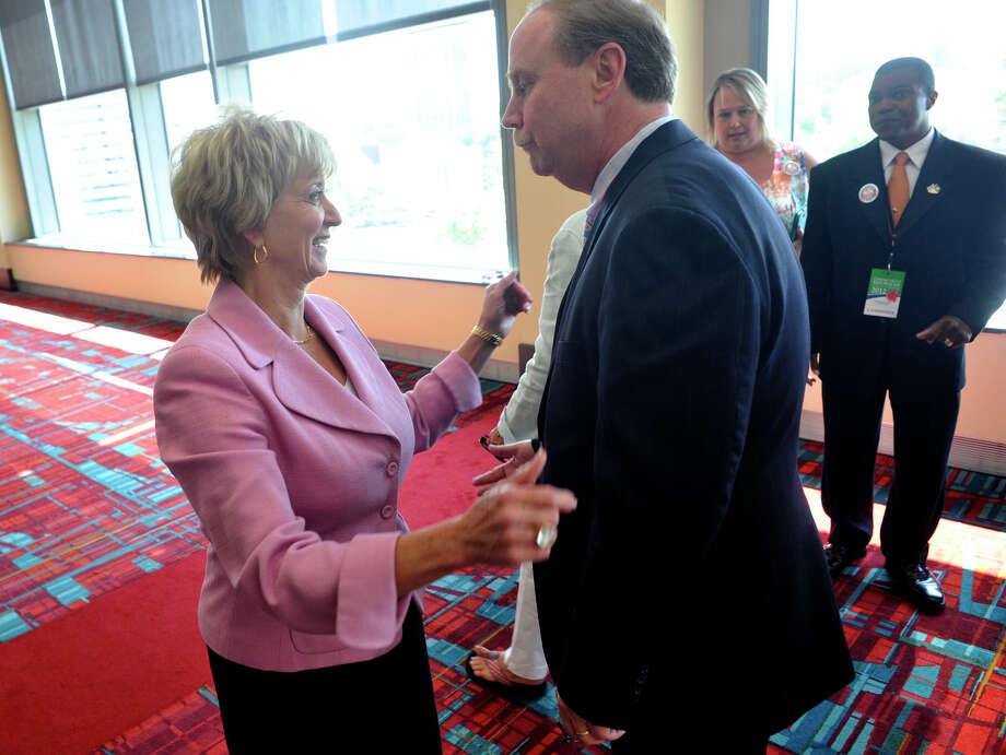 Candidate for U.S. Senate Linda McMahon greets State Sen. Michael McLachlan, of Danbury, during the state Republican convention at the Connecticut Convention Center in Hartford, Conn., on Friday, May 18, 2012. Photo: Jason Rearick / The News-Times