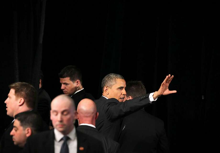 WASHINGTON, DC - MAY 18:  U.S. President Barack Obama (R) waves as he leaves after addressing the Symposium on Global Agriculture and Food Security May 18, 2012 at the Ronald Reagan Building in Washington, DC. The symposium, hosted by the Chicago Council on Global Affairs, in collaboration with the World Economic Forum, was to discuss new activities to advance global agricultural development, food and nutrition security in Africa.  (Photo by Alex Wong/Getty Images) Photo: Alex Wong, Getty Images