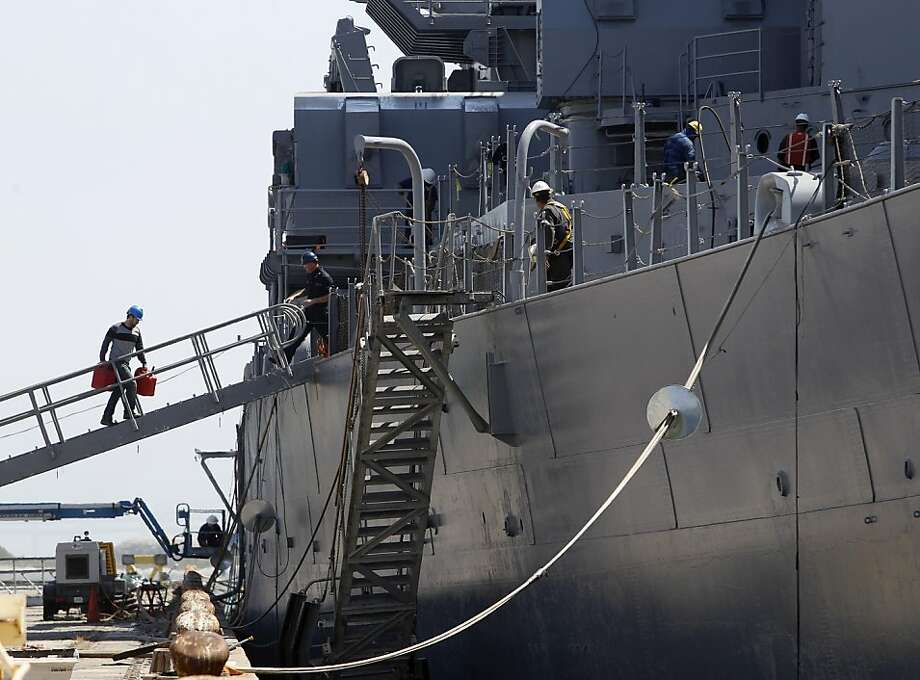 Equipment is carried aboard the USS Iowa in Richmond, Calif. on Friday, May 18, 2012, while crews prepare the retired battleship for her final voyage to San Pedro on Sunday. Photo: Paul Chinn, The Chronicle