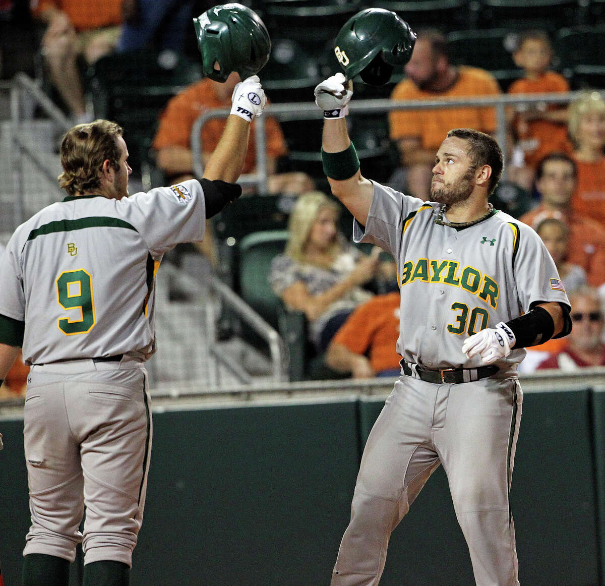 Josh Ludy gets a high hat from Max Muncy (9) after drilling a solo homer to put the Bears up 4-0 as Texas plays Baylor at Disch-Falk Field in Austin on May 18, 2012. Tom Reel/ San Antonio Express-News