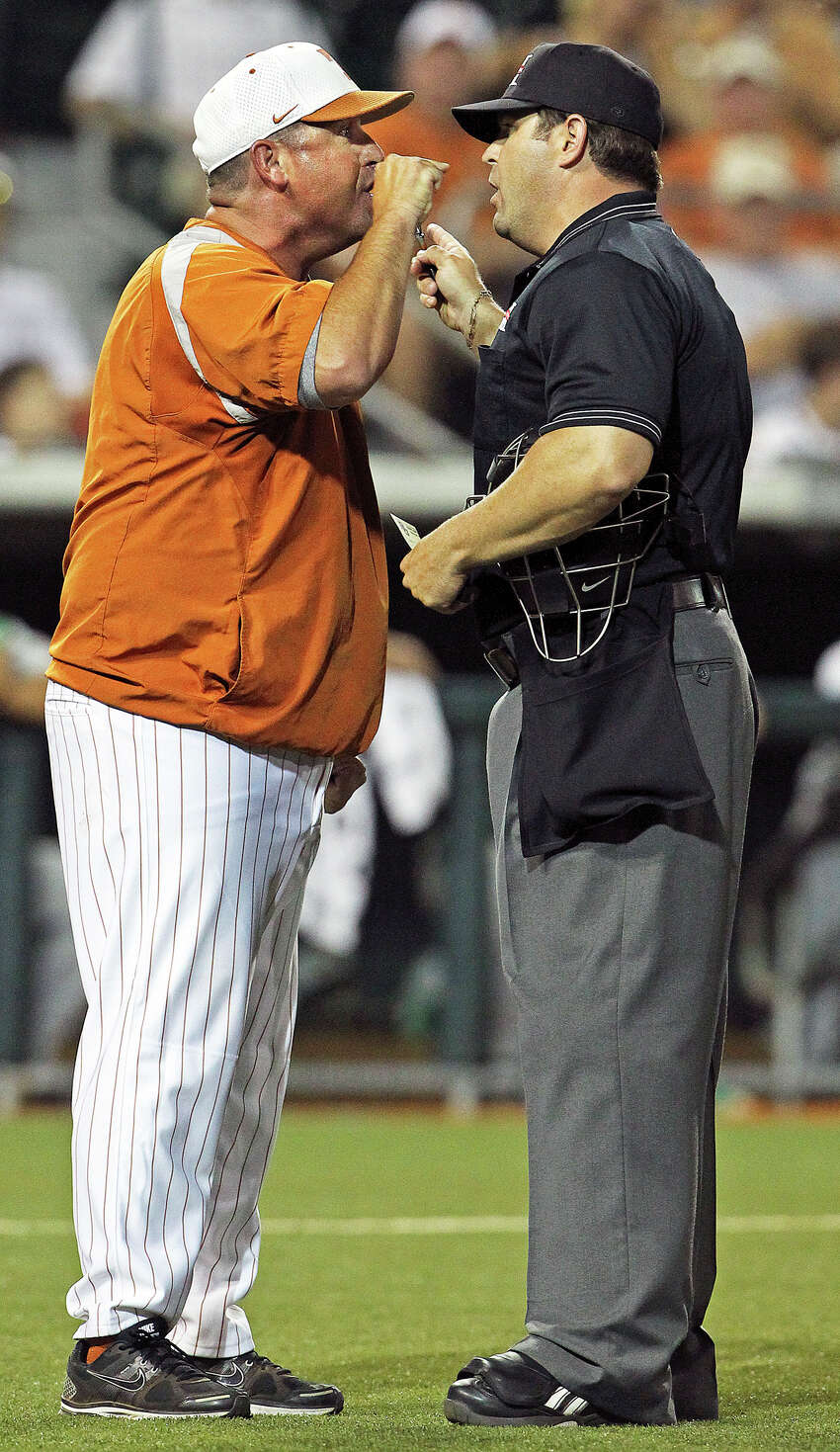SPORTS UT pitching coach Skip Johnson continues to argue with the home plate umpire after he was tossed out of the game as Texas plays Baylor at Disch-Falk Field in Austin on May 18, 2012. Tom Reel/ San Antonio Express-News