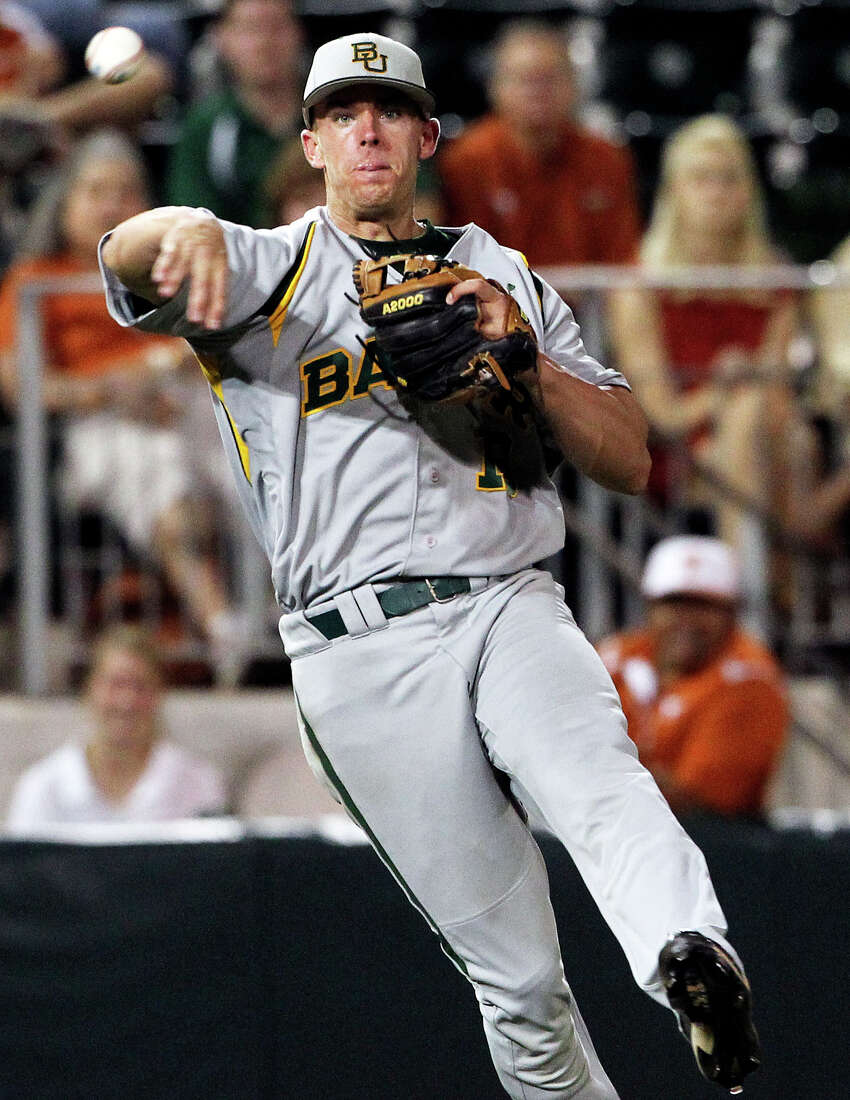 SPORTS Baylor third baseman Cal Towey throws to get the final out as Texas loses to Baylor 4-0 at Disch-Falk Field in Austin on May 18, 2012. Tom Reel/ San Antonio Express-News