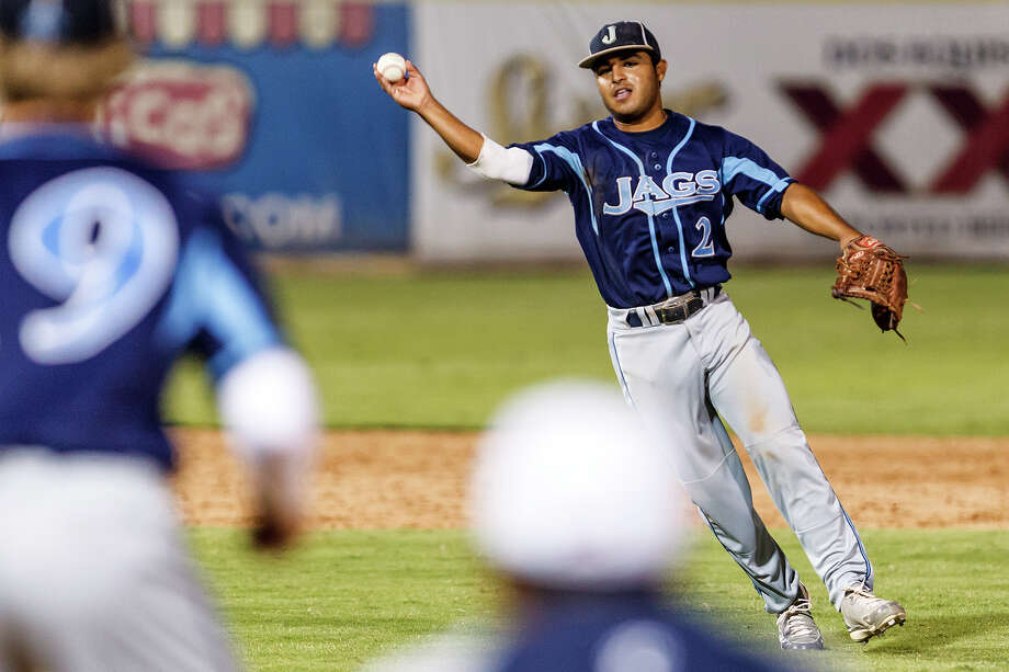 Johnson's Joseph Collazo throws to first baseman Cody Dunlap during the opening game of Johnson's third round series with Corpus Christi Carroll at Nelson Wolff Stadium on May 18, 2012.  Johnson won the game 3-2 .  MARVIN PFEIFFER/ mpfeiffer@express-news.net Photo: Marvin Pfeiffer/ Express-News