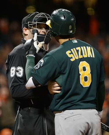 SAN FRANCISCO, CA - MAY 18:  Kurt Suzuki #8 of the Oakland Athletics argues a called strike three with home plate umpire Mike Estabrook #83 in the eighth inning against the San Francisco Giants at AT&T Park on May 18, 2012 in San Francisco, California. The Giants won the game 8-6. (Photo by Thearon W. Henderson/Getty Images) Photo: Thearon W. Henderson, Getty Images