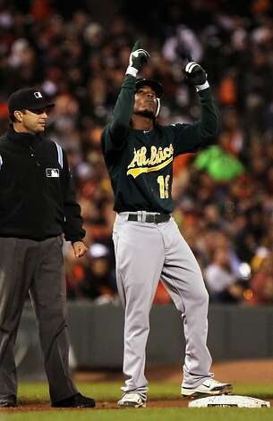 Oakland Athletics Jemile Weeks looks up and celebrates his thriple in the sixth inning against the San Francisco Giants Friday, May 18, 2012 in San Francisco Calif. Photo: Lance Iversen, The Chronicle
