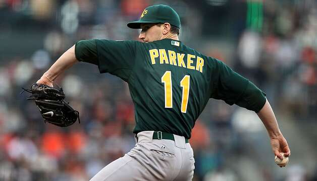Oakland Athletics starting pitcher Jarrod Parker throws to the San Francisco Giants during the first inning of their MLB baseball game Friday, May 18, 2012 in San Francisco Calif., Photo: Lance Iversen, The Chronicle