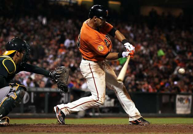 San Francisco Giants Angel Pagan hits a stand-up double against Oakland Athletics pitcher Jerry Blevins in the fourth inning of their MLB baseball game Friday, May 18, 2012 in San Francisco Calif. Photo: Lance Iversen, The Chronicle