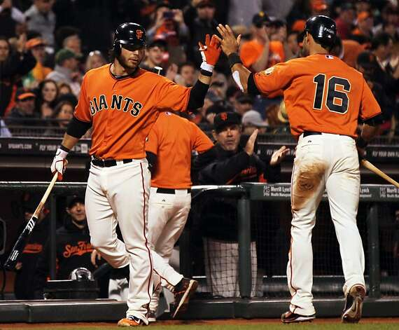 Brandon Crawford greets Angel Pagan after the center fielder scored on a bases-loaded walk to Barry Zito. Photo: Lance Iversen, The Chronicle