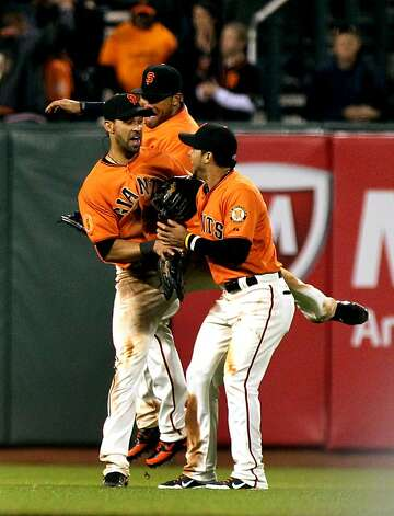 San Francisco Giants outfielders Gregor Blanco, Milky Cabrera and Angel Pagan celebrate their 8-6 win over the Oakland Athletics Friday, May 18, 2012 in San Francisco Calif. Photo: Lance Iversen, The Chronicle