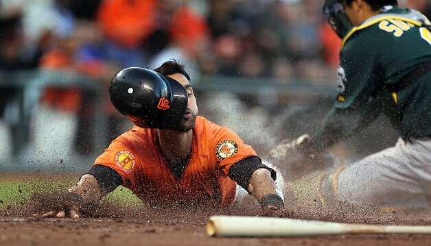 Angel Pagan slides past Kurt Suzuki to score on  Brandon Belt's single in the second inning for the first of the Giants' eight runs. Photo: Lance Iversen, The Chronicle