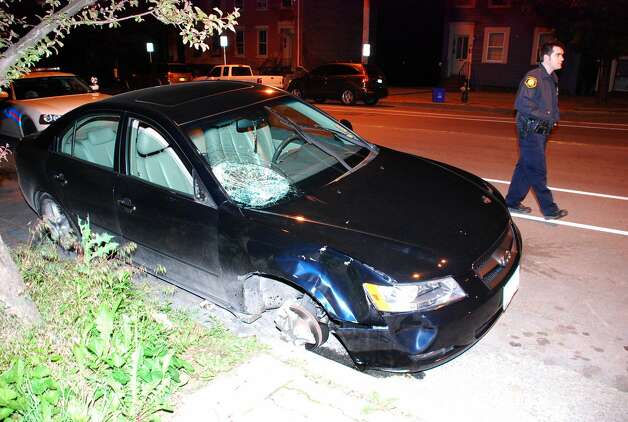 The car allegedly involved in an early morning hit-and-run accident on Albany's North Pearl Street on Saturday, May 19, 2012. (Thomas Heffernan Sr./Special to the Times Union) Photo: Picasa