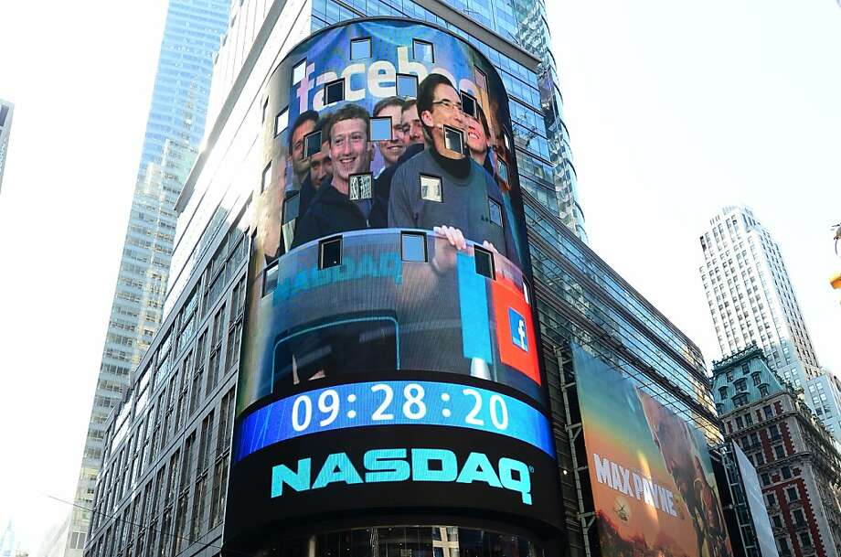 TOPSHOTS Facebook co-founder Mark Zukerberg is seen on a screen getting ready to ring the NASDAQ stock exchange opening bell in Times Square in New York, May 18, 2012. Facebook is set to go public on May 18, 2012 and is likely to have an estimated market valuation of over 100 billion USD when its shares begin trading on the NASDAQ. AFP PHOTO/Emmanuel DunandEMMANUEL DUNAND/AFP/GettyImages Photo: Emmanuel Dunand, AFP/Getty Images