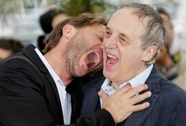 Actor Thomas Kretschmann, left and director Dario Argento interact during a photo call for Dario Argento Dracula at the 65th international film festival, in Cannes, southern France, Saturday, May 19,
