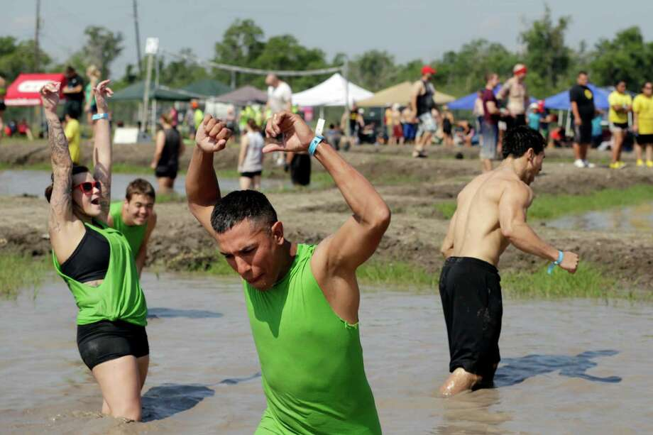 The Mud Sharks team, including Stephen Bell, center, celebrates a match. Photo: TODD SPOTH, For The Chronicle / © TODD SPOTH, 2012