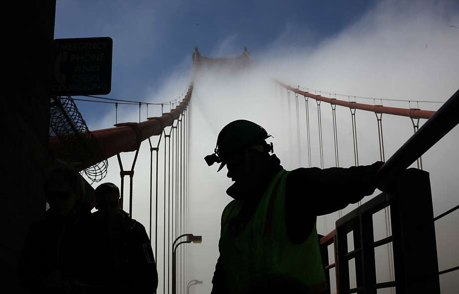 Electrician Jamie Briggs tends to maintenance duties on the north end of the Golden Gate Bridge on May 8, 2012 in Marin, Calf. Photo: Mike Kepka, The Chronicle