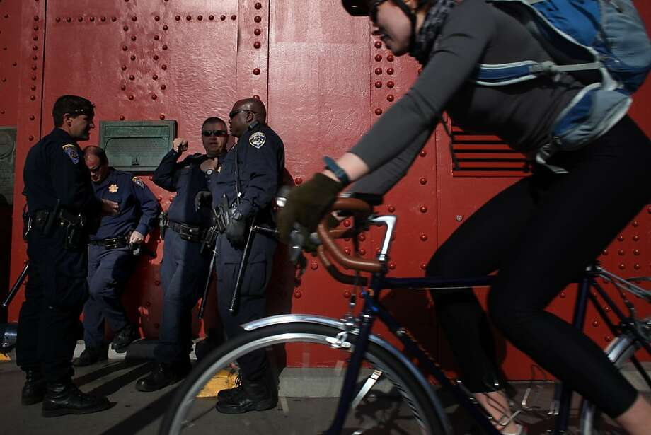 Posted in the event of May Day protests, California Highway Patrol Officers standby at the base of the south tower on the Golden Gate Bridge on May 1, 2012 in San Francisco, Calif. Photo: Mike Kepka, The Chronicle