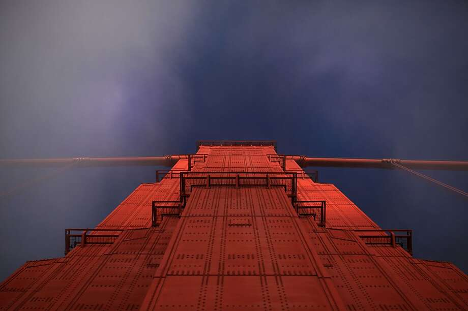 Early morning fog whips the top of the north tower of the Golden Gate Bridge on May 8, 2012 in San Francisco, Calif. Photo: Mike Kepka, The Chronicle