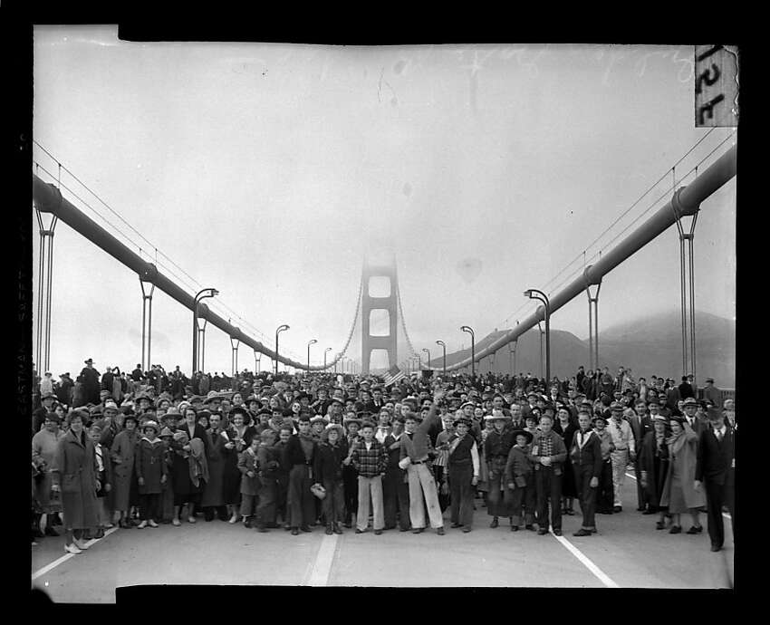 Pedestrians walk across the Golden Gate Bridge on May 27, 1937. San Francisco Chronicle archive photos of the Golden Gate Bridge construction and opening to the public. The city of San Francisco will celebrate the Golden Gate Bridge's 75th anniversary on Sunday, May 27, 2012.