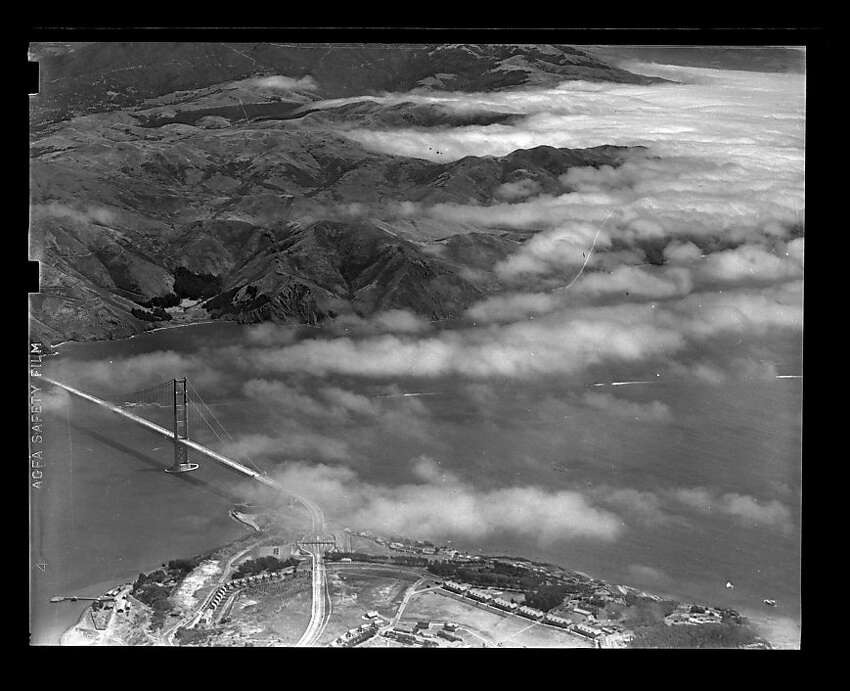 Aerial photo of Golden Gate Bridge with fog in Marin on unknown date. Library envelope says opening day, but there is no foot traffic and minimal vehicle traffic on the bridge. San Francisco Chronicle archive photos of the Golden Gate Bridge construction and opening to the public. The city of San Francisco will celebrate the Golden Gate Bridge's 75th anniversary on Sunday, May 27, 2012.San Francisco Chronicle archive photos of the Golden Gate Bridge construction and opening to the public. The city of San Francisco will celebrate the Golden Gate Bridge's 75th anniversary on Sunday, May 27, 2012.