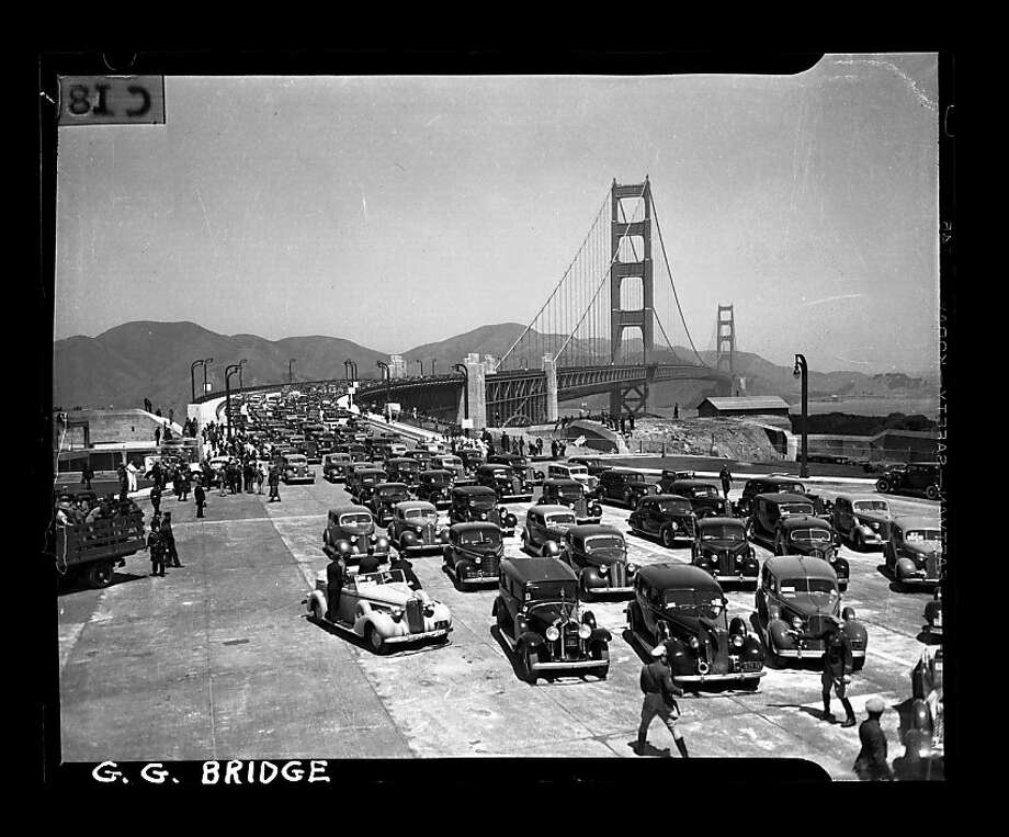 Auto parade on the opening day of the Golden Gate Bridge heading southbound on May 27, 1937. San Francisco Chronicle archive photos of the Golden Gate Bridge construction and opening to the public. The city of San Francisco will celebrate the Golden Gate Bridge's 75th anniversary on Sunday, May 27, 2012. Photo: San Francisco Chronicle