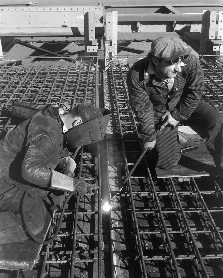 Workers welding the rebar before the roadway concrete was poured. for  the Golden Gate Bridge. Photo: Www.goldengate75.org